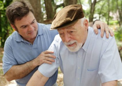worried son with dad wondering if he should use a GPS tracker for his parent with dementia