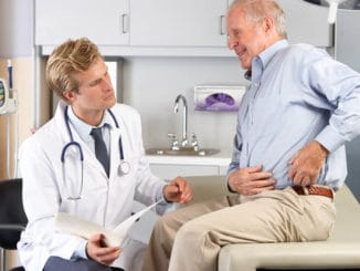 man talking to doctor about how to relieve arthritic hip pain