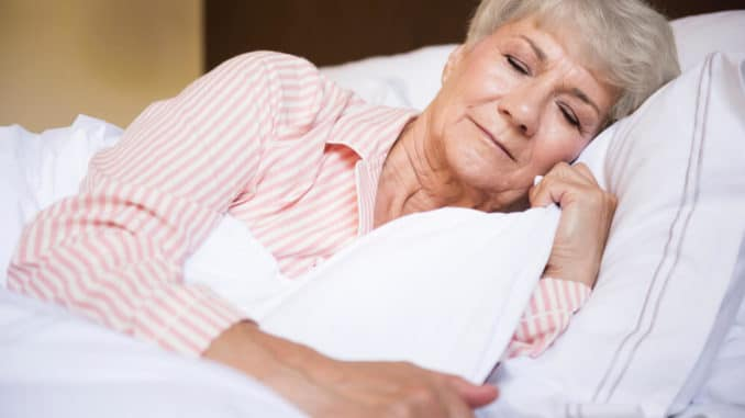 woman with arthritic hip pain sleeping on her side