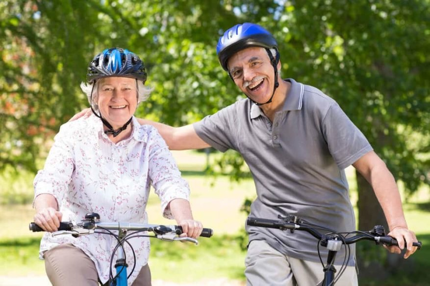 smiling senior couple after replacing their seat with the best bicycle seat for seniors