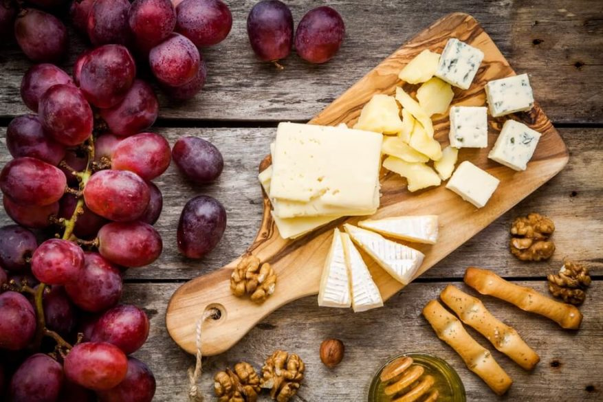 different protein filled cheeses on a wooded cutting board