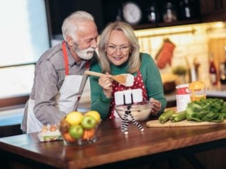 man with dementia cooking with his wife