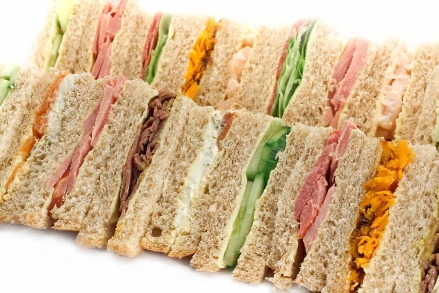 various finger sandwiches on a tray