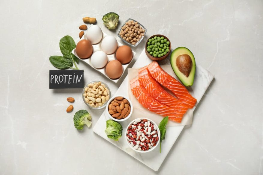 selection of various high protein foods for the elderly including mean, beans, eggs and some veggie choices too.