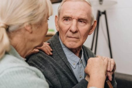 wife talking with her husband with dementia