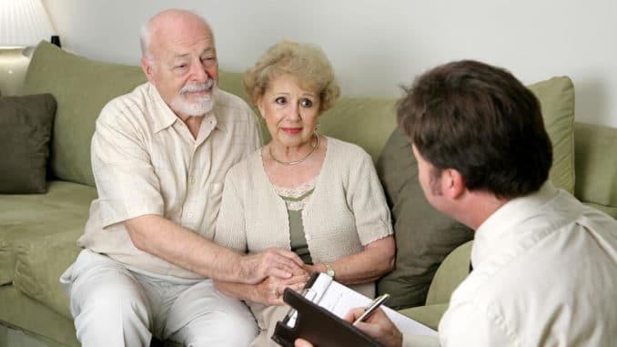 salesman talking to senior couple