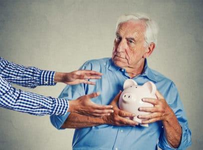 senior man with dementia protecting his savings
