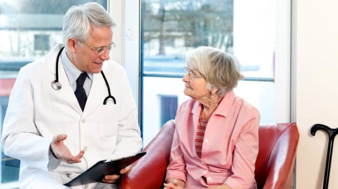 elderly woman consults with her doctor about the causes of falls in the elderly