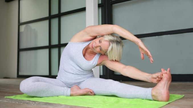 senior woman doing a yoga pose