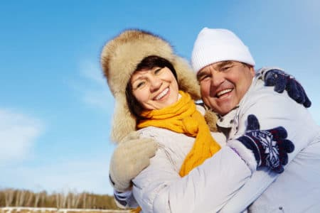 older couple enjoying outdoor winter activities for seniors