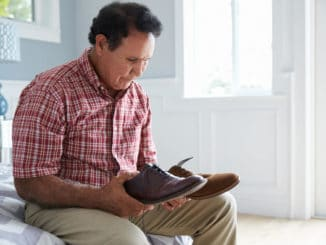 senior man choosing proper footwear for him to prevent falls