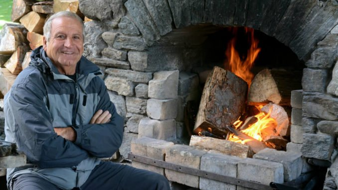 Put your outdoor fireplace or a simple fire pit to use as a hub for senior-friendly outdoor activities for seniors.
