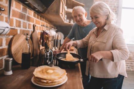 senior woman holding a lightweight pan