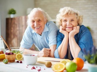 seniors smiling in kitchen
