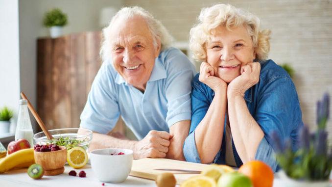 seniors smiling in kitchen