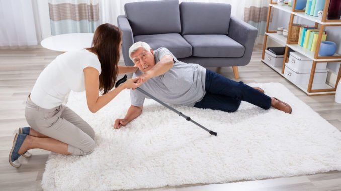 daughter helping her elderly father up after he keeps falling