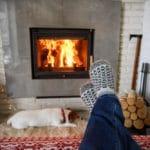 feet in warms socks for senior beside the fire