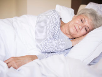 senior woman sleeping with a weighted blanket for side sleepers