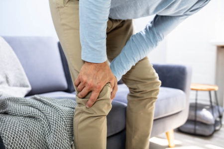 senior man with knee pain after using weighted blanket