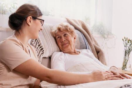 bedridden elderly woman at home