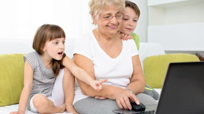 grandmother playing online games with her grandkids