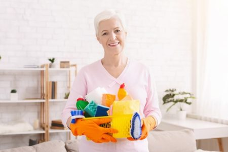 senior woman showing tools for cleaning with arthritis