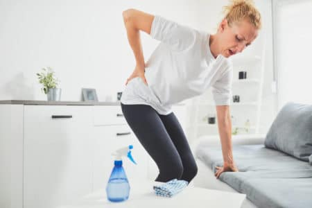 woman with arthritis pain from cleaning her house