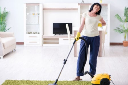 senior woman with aching back from cleaning house