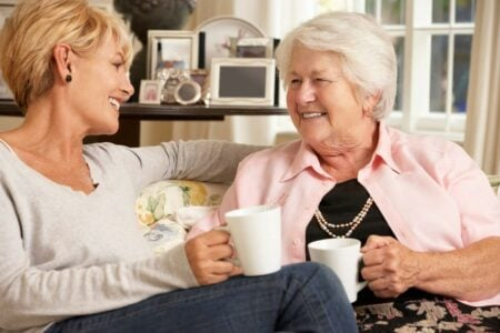 senior with dementia reminiscing with her daughter