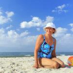 senior woman posing with beach ball