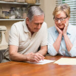 couple looking at ways to pay for nursing home for elderly parents