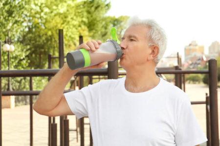 senior man enjoying a meal replacement shake