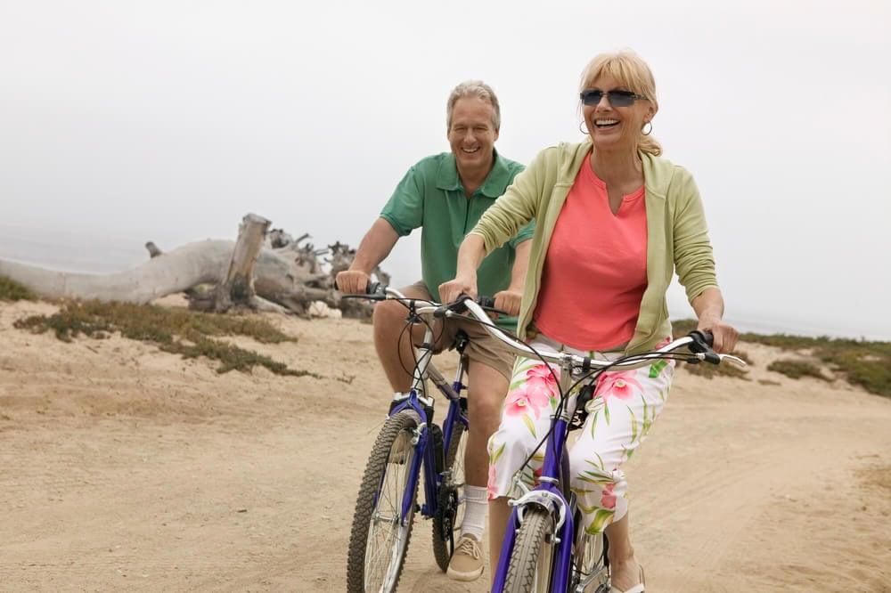 seniors riding beach cruiser bike