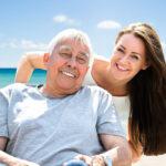 senior man in wheelchair at beach