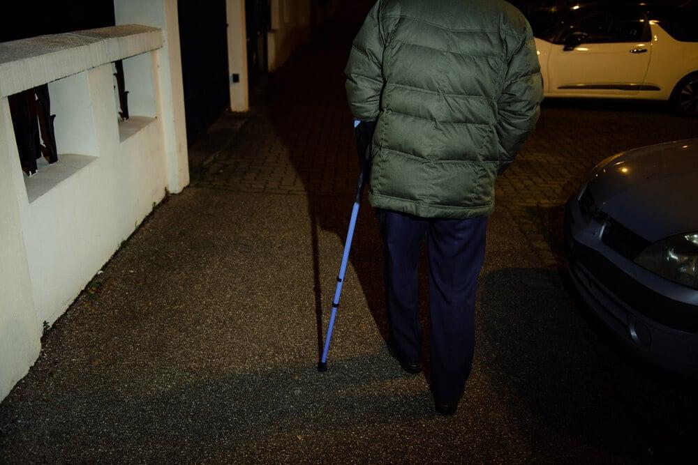 senior-with-cane-walking-at-night