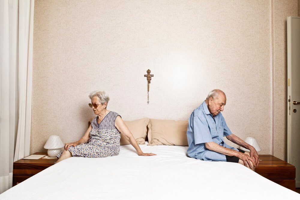 elderly couple getting out of bed