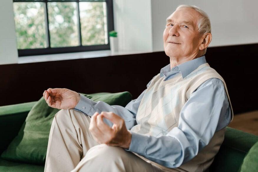 elderly man meditating