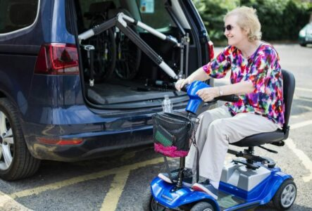 senior woman in mobility scooter